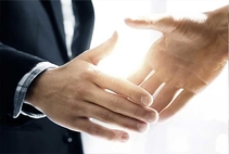 two men shaking hands in suits